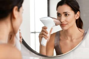 woman using philips lumea prestige ipl on face