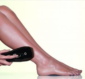 woman using smoothskin ipl device on legs