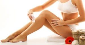 woman epilating legs