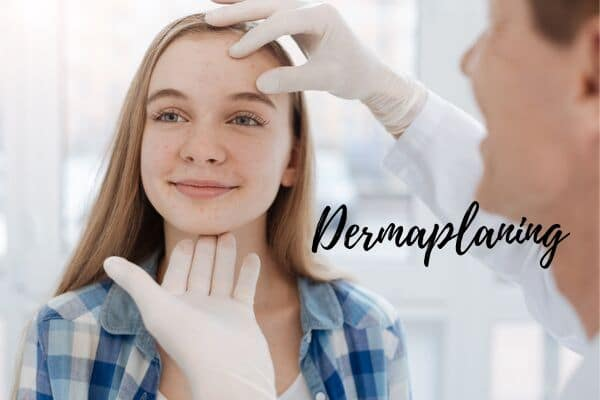 dermaplaning face at dermatologist