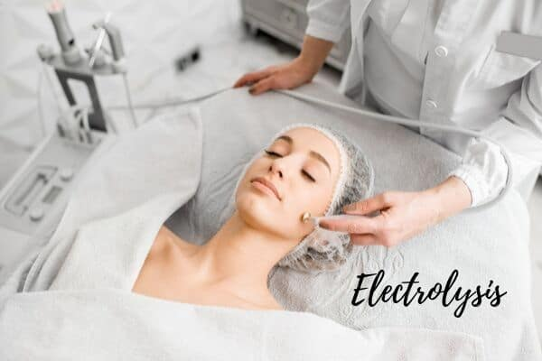 woman receiving electrolysis on the face